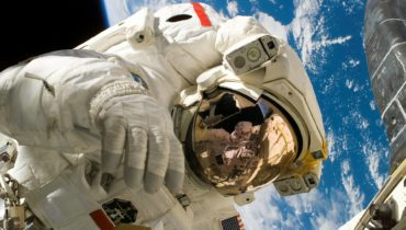 Astronaut Repairing International Space Station revolving in Space-2